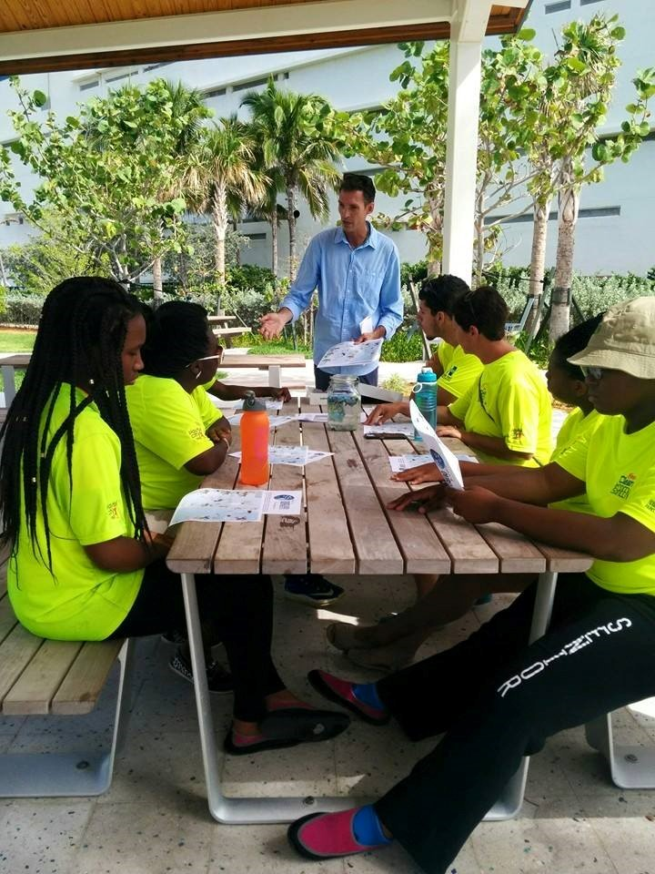 Friends of Our Florida Reefs volunteer Todd Peterson presents an overview of coral reef and beach ecology to the Hallandale Beach Green Team this past summer. Photo: Scott Sheckman