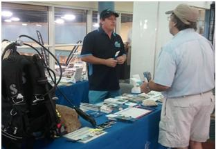 CRCP staff engaging a stakeholder at the Miami International Boat Show. Photo: Lauren Waters