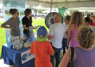 Members of the Coral Reef Conservation Program explain the Southeast Florida Coral Reef Initiative and its efforts to members of the community at the Miami River Day.